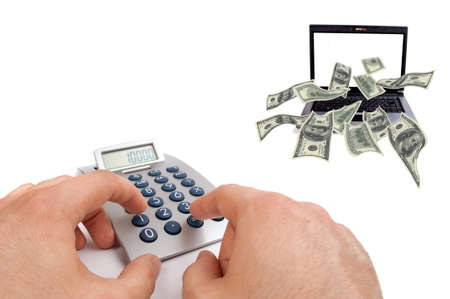 Male hands calculate earnings over the internet while dollar bills flying from the laptop screen photo