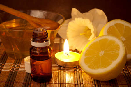 Essential oil, lemon and honey for spa treatment photo