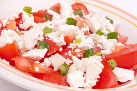 Fresh tomato salad with goat feta cheese and young chopped onion sprout Stock Photo - 13542728