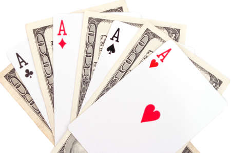 Poker of aces and hundred-dollar bills, isolated on white photo