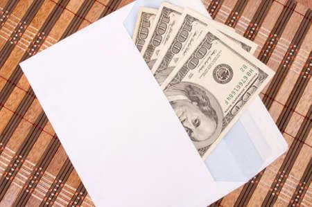 Four hundred-dollar bills in an envelope photo