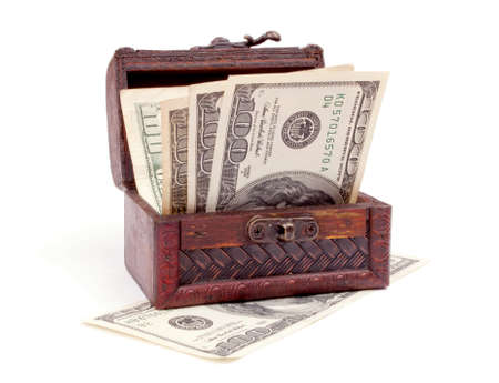 American hundred-dollar bills in the wooden chest, isolated on white photo