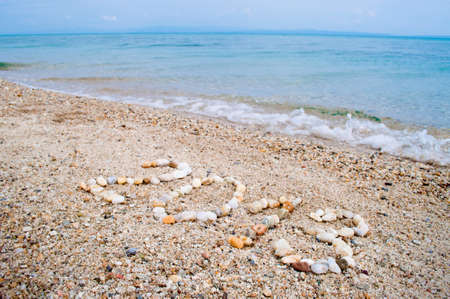 The year 2013 made ??of small stones on the sandy beach photo