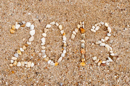 The year 2013 made of small stones on the sandy beach photo