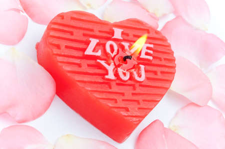 I Love You decorative candle with pink petals around photo