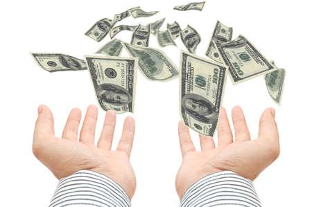 錢: 美國百元帳單飛向伸出雙手 版權商用圖片