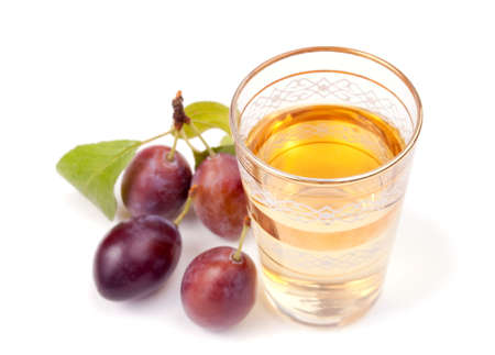 Serbian alcoholic drinks and plums isolated on white Stock Photo