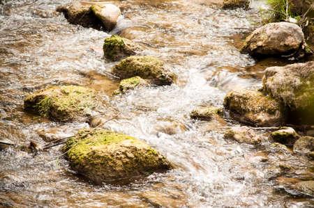 Small river cascade between stones photo
