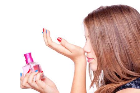 smell: Perfume Adolescente sosteniendo la mano y perfumado aroma, aislado en blanco Foto de archivo