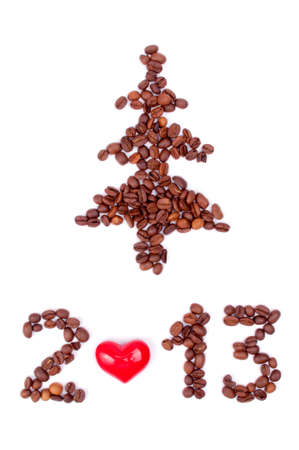 Tree and year 2013 made from coffee beans and heart, isolated on white photo