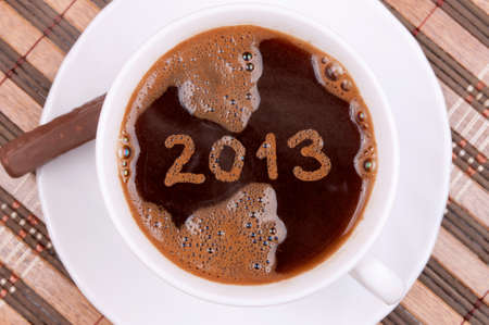 New year 2013 handwritten on the coffee surface in the cup, with coffee foam texture photo