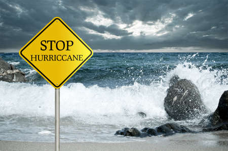 Sign ,Stop hurricane and rough sea with stormy clouds in the background photo