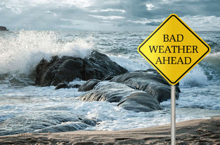 Sign for bad weather with roughs sea, waves and stormy clouds in the background photo