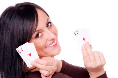 Woman holding four aces in her hands, isolated on white - all aces in my hand concept photo
