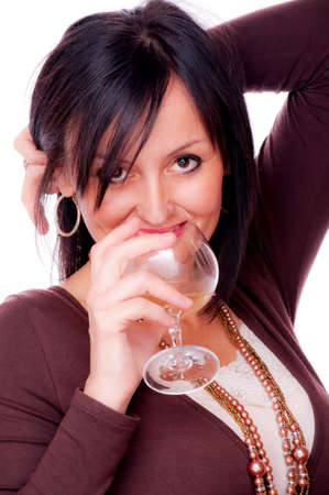 Beautiful woman drinking white wine, on the white background photo