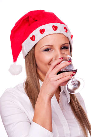 Young girl with Santa hat drinking red wine, isolated on white Stock Photo - 16431805