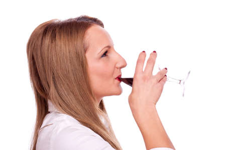 Young beautiful girl drinking red wine, isolated on white Stock Photo - 16518793