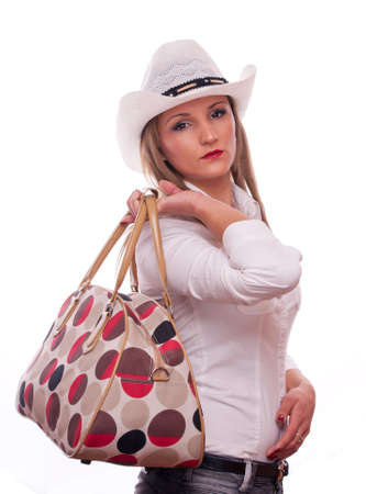 Young girl with hat, holding bag, isolated on white Stock Photo - 16518789