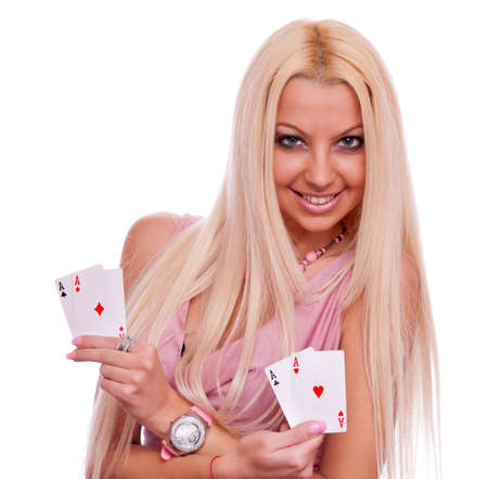 Beautiful blonde holding four aces, two in each hand - all aces in my hands