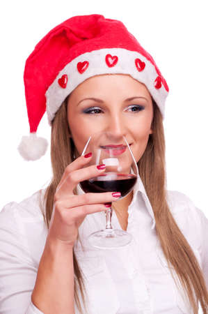 Young girl with Santa hat drinking red wine, isolated on white photo
