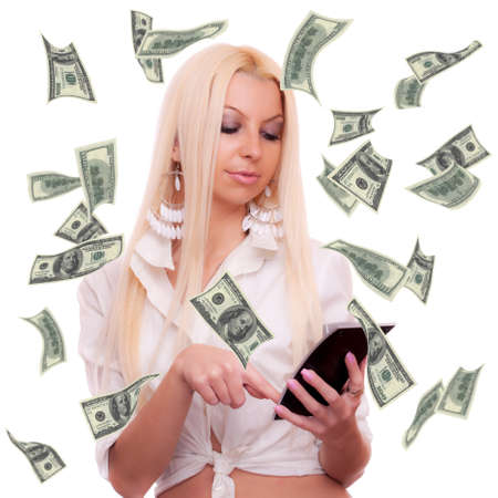 American hundred Dollar bills flying around beautiful blonde who calculate on the calculator, isolated on white photo