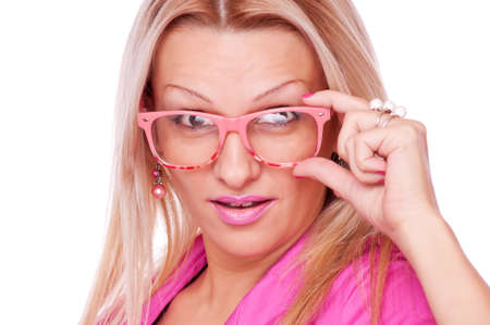 Surprised beautiful blonde holding eyeglasses, isolated on the white background Stock Photo - 16763463