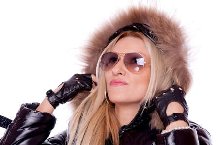 Lovely blonde in the black jacket with hood and sunglasses, isolated on white Stock Photo - 16780087