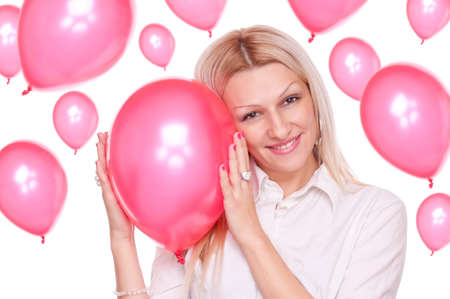 Attractive blonde holding red balloon and many balloons in the background, isolated on white Stock Photo - 16974456
