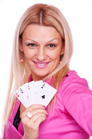 Beautiful blonde with smile on the face holding four aces in the hand, isolated on white Stock Photo - 16974460