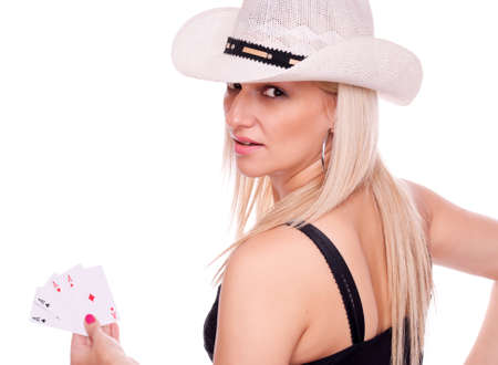 Lovely blonde with hat holding four aces and looking at camera, isolated on white photo