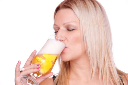 Beautiful blonde enjoys drinking beer, isolated on white Stock Photo - 17039102