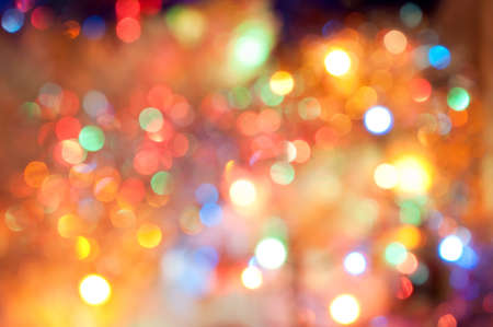 Abstract background with bokeh defocused colorful lights - image of defocused lights on the Christmas tree photo