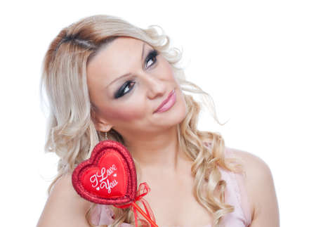 Beautiful blonde holding red heart with words