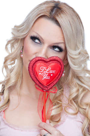 Beautiful blonde smiling and holding red heart with words