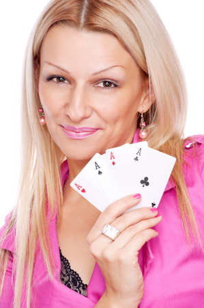 Beautiful blonde with smile on the face holding four aces in the hand, isolated on white photo