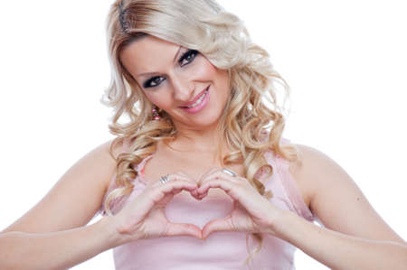 Beautiful blonde make heart shape by her hands, isolated on white Stock Photo - 17281917