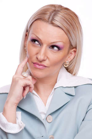 Beautiful blonde holding index finger on the face and thinking Stock Photo - 17605227