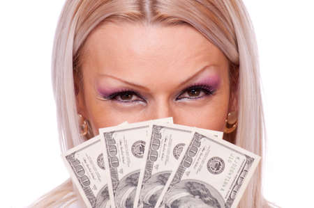 Close up shot of a blonde holding a fan of hundred-dollar bills Stock Photo - 17605242