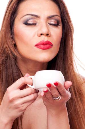 Beautiful women enjoy the smell of fresh coffee photo