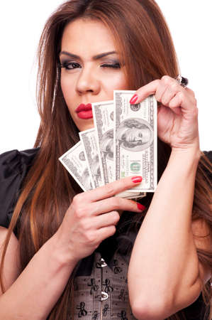 Beautiful brunette holding American Dollar bills and winking photo