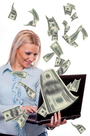 Attractive blonde holding laptop and american Dollar bills flying from screen - making money concept Stock Photo