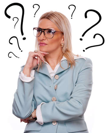 Business woman thinking - question marks around head Stock Photo - 18494175