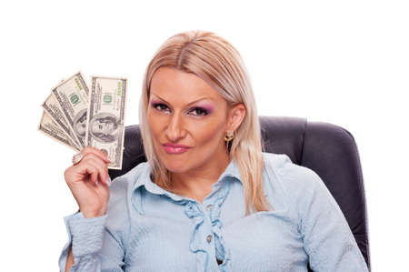 Beautiful blonde sitting in the office chair and holding American Dollar bills photo