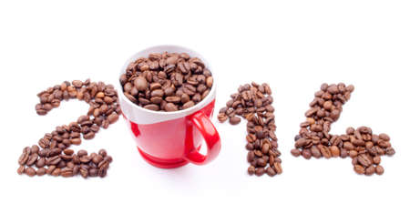 New Year 2014 made of coffee beans and cup on the white background  photo