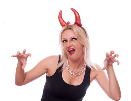 Pretty blonde with red devil horns frighten someone, isolated on white photo