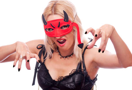 Pretty blonde with red devil mask frighten someone, isolated on white photo