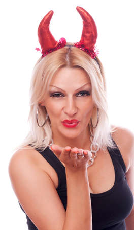 Beautiful blonde woman with red horns sending kiss, isolated on white photo