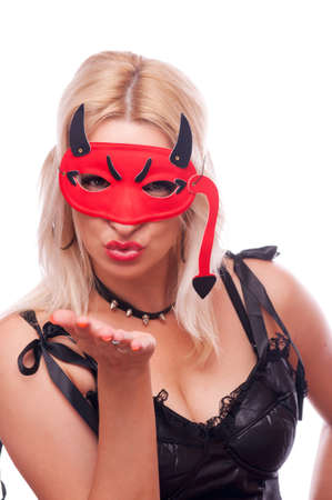 Pretty blonde with red devil mask sending kiss, isolated on white photo