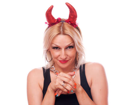 Pretty blonde with red devil horns with naughty expression, isolated on white photo