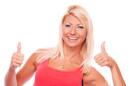 Beautiful smiling blond girl showing thumbs up with booth hands, isolated on white photo